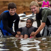 Colsac Skier volunteers Josh Bader, 15, of Sauk City, left, and Will Alt, 15, of Sauk City, right, help J.R. Winne of Plover, center, sit-down water skis during the Big Pull event at Lake Wazeecha in Grand Rapids, Saturday, Aug. 29, 2015. Colsac Skiers is an adaptive water ski school based on Lake Wisconsin that was participating in the Big Pull.