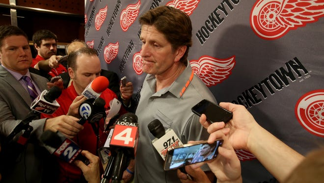 Former Detroit Red Wings coach Mike Babcock talks to the media in the team's locker room at Joe Louis Arena in Detroit, Michigan on Friday, May 22, 2015. Babcock is leaving the Red Wings after 10 years in the organization to coach the Toronto Maple Leafs.