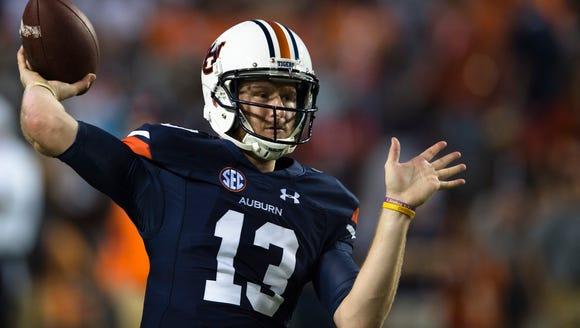 Auburn quarterback Sean White (13) throws a pass before