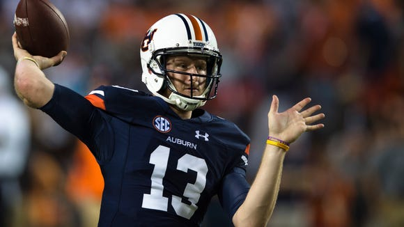 Auburn quarterback Sean White (13) throws a pass before the Auburn vs. Clemson NCAA Football game at Jordan-Hare Stadium on the campus of Auburn University in Auburn, Ala. They are all a member of the newly official Super Fan at Auburn. 