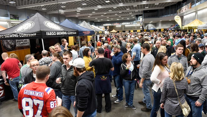 People fill a section of the exhibition hall Saturday, Jan. 21, during the St. Cloud Craft Beer tour at the River's Edge Convention Center in St. Cloud.