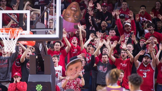 Rutgers student-fans cheer at the basketball game against Minnesota Saturday.