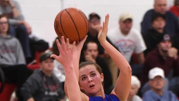 Utica's Carli Conard tries to block a shot from Lakewood's Courtney Vierstra. The Lancers defeated Utica 51-49 on Wednesday, Jan. 18, 2017.