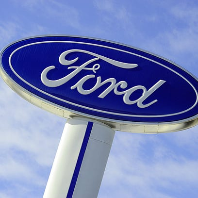 The Ford logo is seen on a sign at a dealership in Hudson, Wisconsin