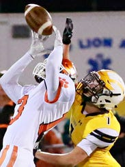 Central York's Tim Sturgis, left, receives a pass while