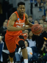 Syracuse guard Tyus Battle dribbles up court against