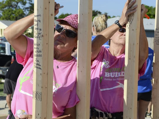 Dolly Scully and Pat Leslie work on a Habitat for Humanity home in Melbourne in August.