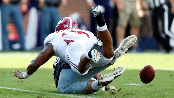 Alabama linebacker Ryan Anderson (22) forces Mississippi quarterback Chad Kelly to fumble in the second half of an NCAA college football game, Saturday, Sept. 17, 2016 in Oxford, Miss. Alabama won 48-43.
