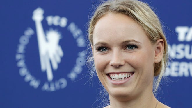 Professional tennis player Caroline Wozniacki talks during a news conference, Wednesday in New York.