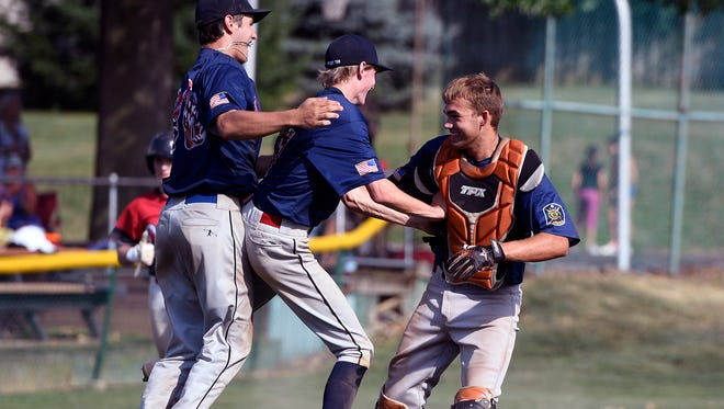 Landon Ness, left, Nick Myers and catcher Nathan Marquard celebrate after Pleasureville defeated Dover in back-to-back games to win the York-Adams American Legion baseball playoff title on Sunday. Pleasureville will compete in the Region 4 playoffs starting Friday morning.  John A. Pavoncello photo
