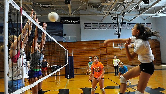 SallyAnne Johnson, right, and Enka are the Mountain Athletic Conference 3-A champions after Tuesday's win at Roberson.