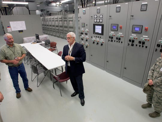 Don Boger, left, and John Raney, give a tour of an