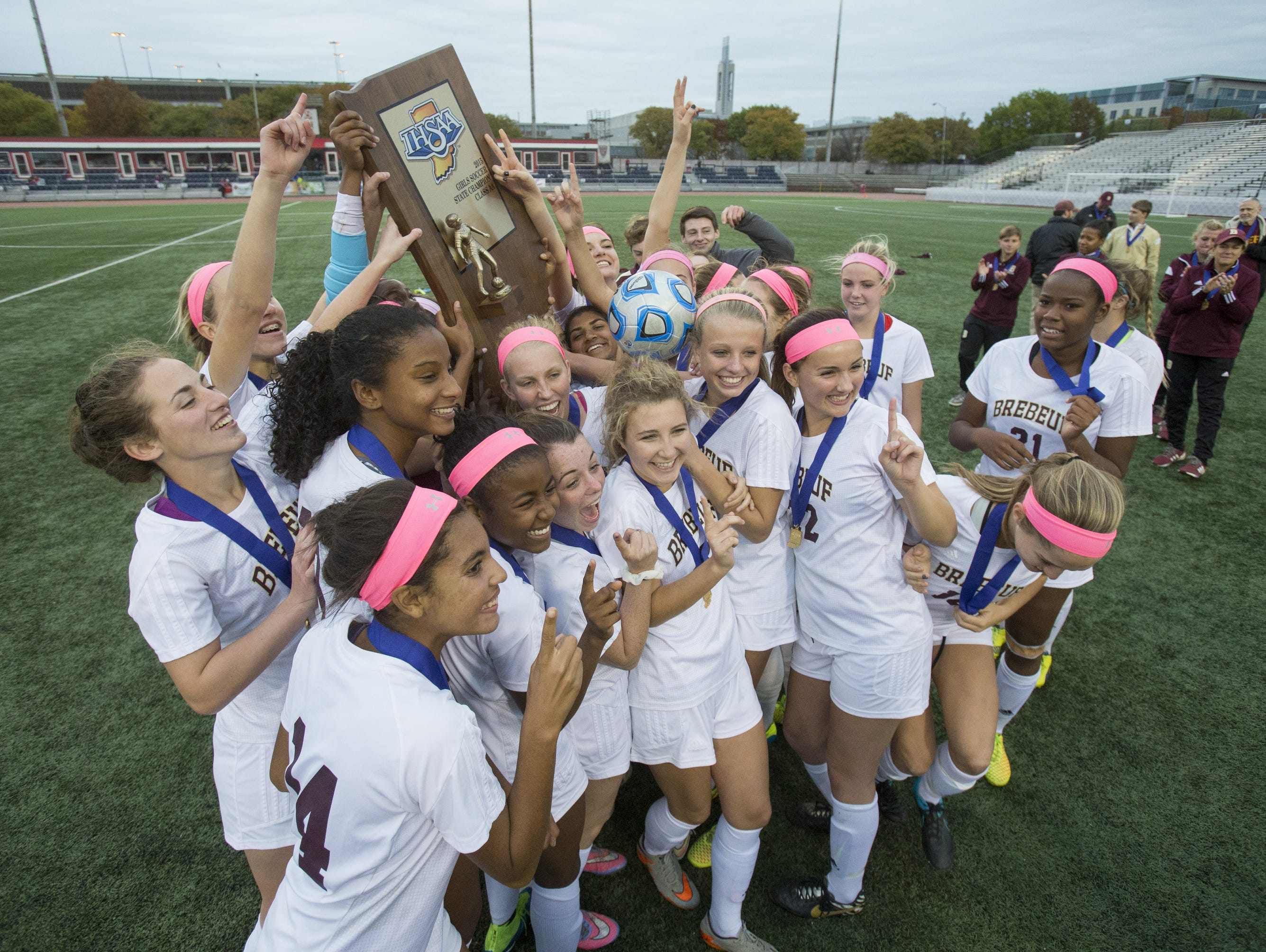 Brebeuf Jesuit High School celebrates their win, IHSAA Girls Class 2A State Soccer Finals, Michael A. Carroll Track & Soccer Stadium, IUPUI, Indianapolis, Saturday, Oct. 31, 2015. Brebeuf Jesuit beat Penn High School, 2-1.