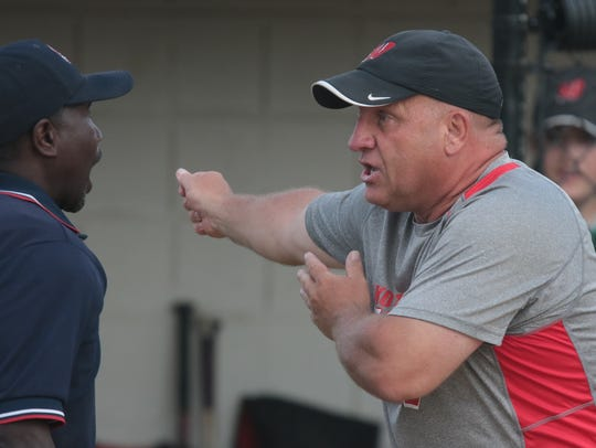 Lakota West head coach Keith Castner argues with home