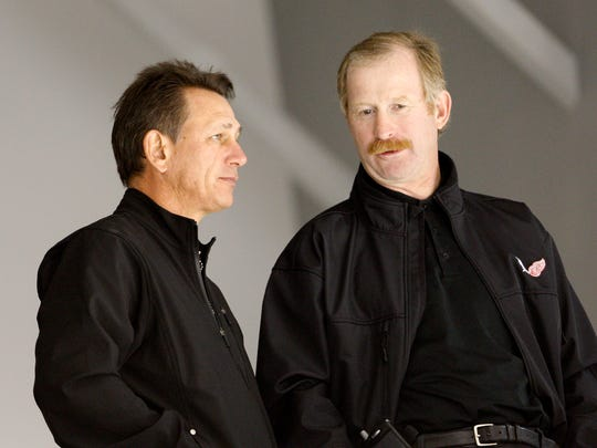 Ken Holland and Jim Nill talk at Red Wings training camp in 2008.