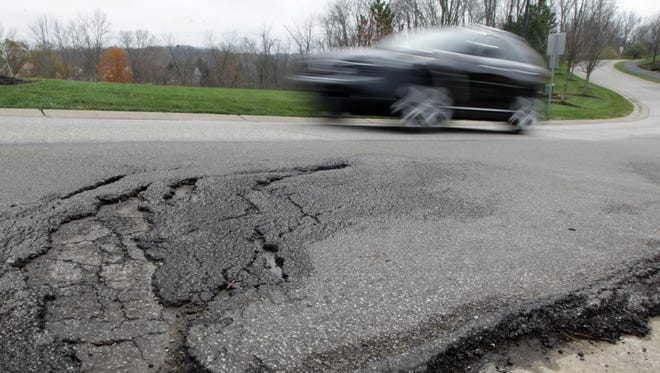 A 6-year-old section of Lakemont Drive in Erlanger is already deteriorating. Roads should last much longer. But in Kenton County, a city or the county is responsible for a road's upkeep 45 days after it is approved.