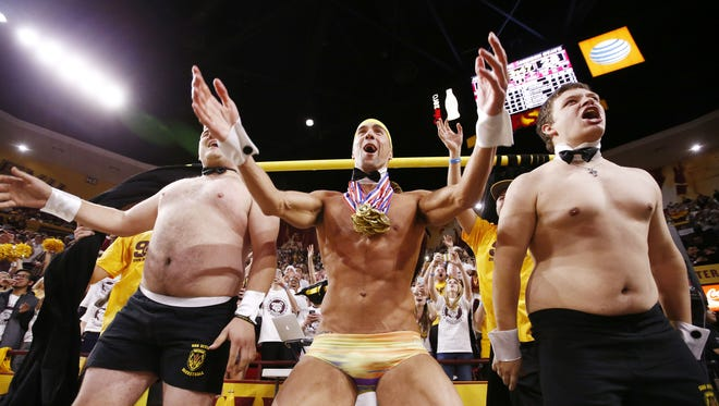 """Michael Phelps, the most decorated Olympian of all time, makes a guest appearance in the """"Curtain of Distraction"""" during the Arizona State game during PAC-12 action on Jan. 28, 2016 in Tempe, Ariz."""
