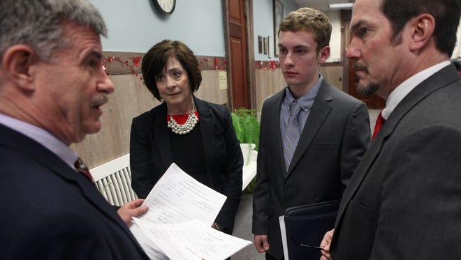 From left, Thomas F. Ferrarese, Democratic commissioner for the Monroe County Board of Elections, looks over petitions submitted Monday by Webster Village Board hopefuls Judy Gurnett and Evan Hoerner, a 17-year-old senior at Webster Schroeder High School. With them is Webster Mayor John Cahill.