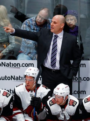 Arizona Coyotes head coach Rick Tocchet directs his team against the Colorado Avalanche in the first period of an NHL hockey game Wednesday, Dec. 27, 2017, in Denver. (AP Photo/David Zalubowski)