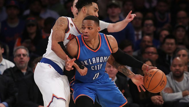Russell Westbrook of the Oklahoma City Thunder drives to the basket against Courtney Lee of the New York Knicks at Madison Square Garden on Monday in New York City. He leads the league in triple-doubles this season.