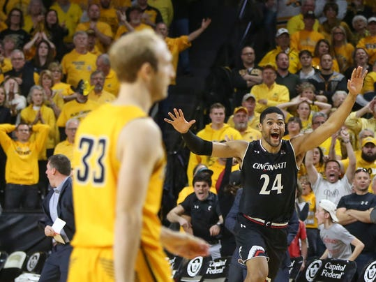 Cincinnati forward Kyle Washington (24) celebrates after Wichita State guard Conner Frankamp (33) missed a three-point basket that would have won an NCAA college basketball game in the American Athletic Conference tournament Sunday, March 4, 2018, in Wichita, Kan. (Travis Heying/The Wichita Eagle via AP)