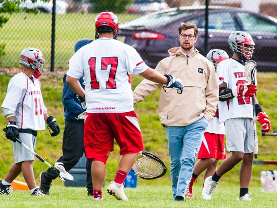 Vineland head coach Michael Kenney congratulates goalkeeper
