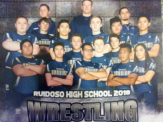 The entire Ruidoso wrestling team is featured on this assembled poster.