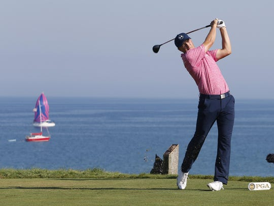 Jordan Spieth hits his tee shot on the 9th hole during