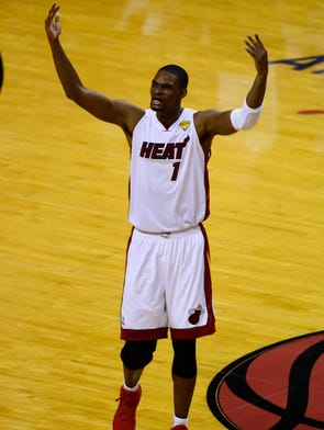 Miami Heat center Chris Bosh waves to the crowd after making three-pointer against the San Antonio Spurs during Game 3 of the 2014 NBA Finals