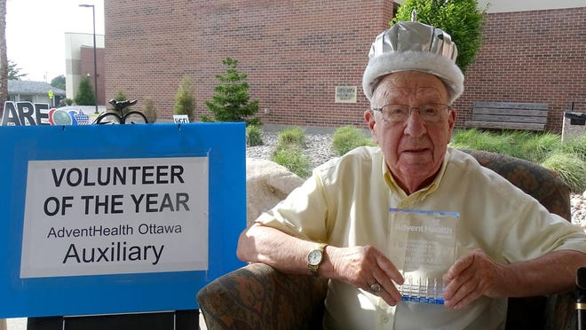 Fred Searls was selected as the 2020 AdventHealth Ottawa Auxiliary Volunteer of the Year. He received the award Tuesday and sat in an easy chair throughout the drive-by awards ceremony.