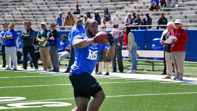 Former Louisiana Tech running back Kenneth Dixon catches passes at Tuesday's Pro Day.