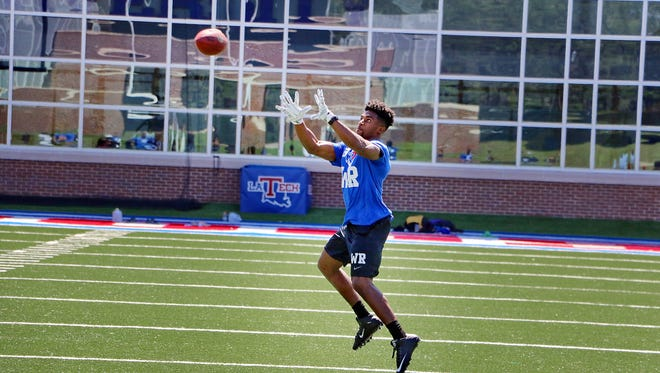 West Monroe native Paul Turner catches a pass during Louisiana Tech's Pro Day in March. Turner is signing with the Eagles as an undrafted free agent.