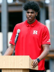 Myles Johnson, power forward for the Rutgers basketball team and engineering student speaks during the topping off ceremony placement of the final piece of structural steel at the  307,000 square foot Rutgers RWJBarnabas Health Athletic Performance Center. June 3, 2018. Piscataway, NJ