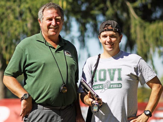 Retiring Novi boys cross country coach Bob Smith (left)
