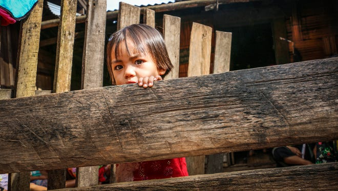 A girl plays in a village in the hill country in northern Thailand.  Traffickers have for years exploited young adults and children from ThailandÕs poor rural villages.