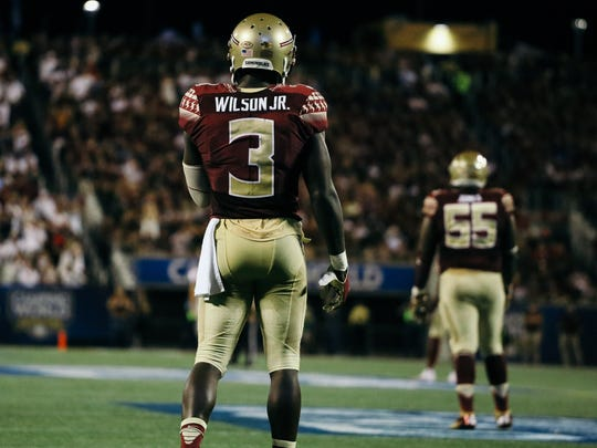 Wilson waits for a kickoff at Camping World Stadium in Orlando during FSU's 45-34 win over Ole Miss.