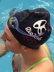 """Carmel swimmer Veronica Burchill wears one of the """"Rio 2016"""" caps distributed as a way to symbolize the team's ambitions."""