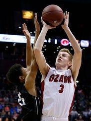 Ozark's Quinn Nelson shoots against Willard in the