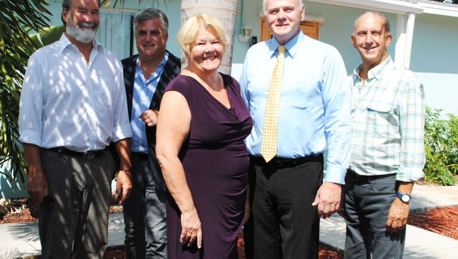 Co-producers Rusty Young (far left) and Marty Paris (far right) flank The Hope for Families of Vero Beach Vice President Brad Upham, Dr. Diana Grossi, interim executive director, and Board President Paul Bradford. Bring non-perishable food items or a monetary donation to the concert.