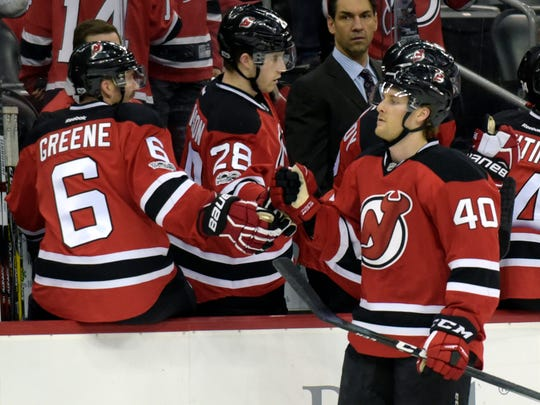 New Jersey Devils center Blake Coleman (40) celebrates his first NHL goal with Andy Greene (6) and Damon Severson (28) during the first period of an NHL hockey game against the Dallas Stars, Sunday, March 26, 2017, in Newark, N.J. (AP Photo/Bill Kostroun)