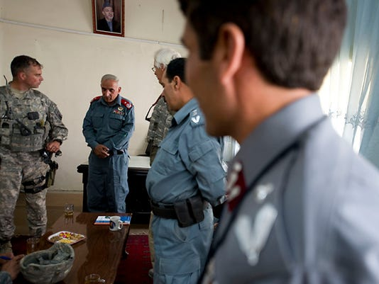 From left, Vermont National Guard Commander for Paktya province Lt. Col. Robert Charlesworth of Jericho meets with Paktya province Deputy Police Chief Gen. Dastageer Rustamyar and his staff in Gardez City on Saturday, September 18, 2010, during Afghanistan's national elections.