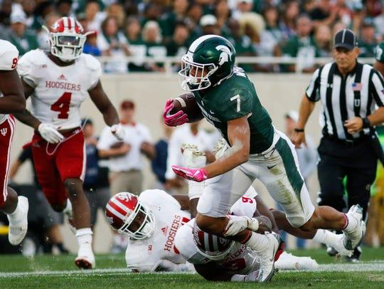MSU WR Cody White gains yardage against Indiana Saturday,