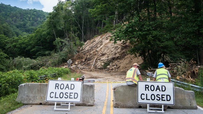 Crews clearing up a mudslide on N.C. 9 near Bat Cave are expected to have the road open by the end of July.