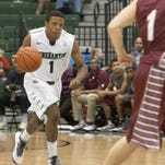 Binghamton University guard Marlon Beck dribbles the ball in a game against Colgate in the Events Center during the 2013-14 season.
