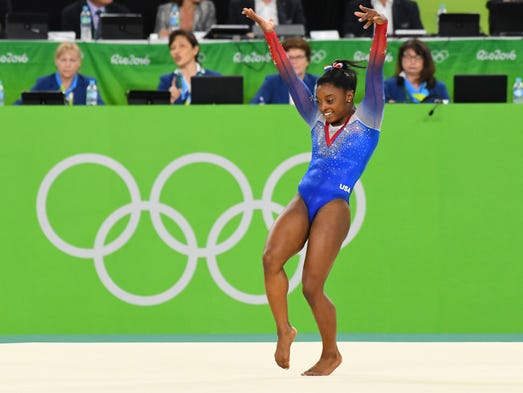 Simone Biles (USA) competes during to the women's floor