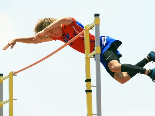 Gregroy-Portland's Taylor McCormick clears the bar as he competes in the boys pole vault during the Region IV-5A Track and Field meet at Alamo Stadium in San Antonio.