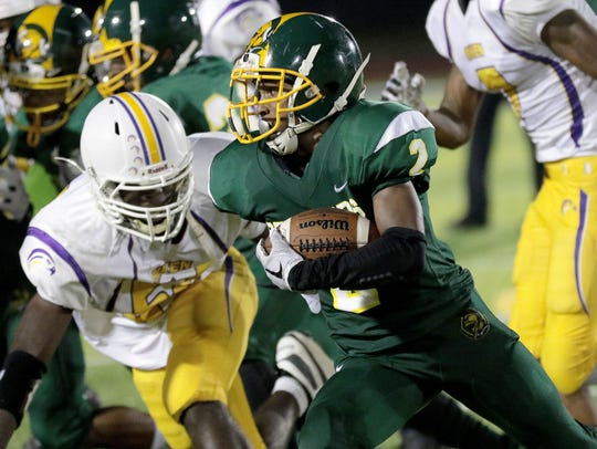 Taft's Demarco Bradley runs the ball during the Senators'