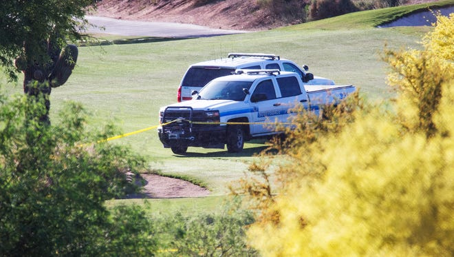 Police vehicles and yellow tape surround the site of a small plane crash near the second hole of the Champions course at TPC Scottsdale, Tuesday, April 10, 2018. The plane crashed Monday night, killing all of those aboard.
