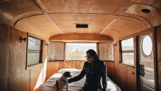 Artist Angel Chen with her dog, Romeo, on her property in Joshua Tree