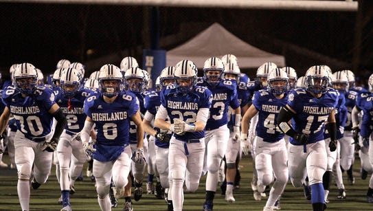 The Highlands Bluebirds take the field in front of